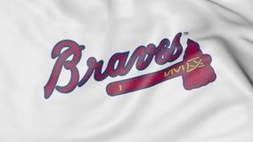 Κινηματογράφηση σε πρώτο πλάνο της κυματίζοντας σημαίας με το λογότυπο ομάδων μπέιζμπολ των Atlanta Braves MLB, τρισδιάστατη απόδ Στοκ εικόνα με δικαίωμα ελεύθερης χρήσης