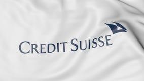 Κινηματογράφηση σε πρώτο πλάνο της κυματίζοντας σημαίας με το λογότυπο ομάδας πιστωτικού Suisse, εκδοτική τρισδιάστατη απόδοση Στοκ Εικόνες