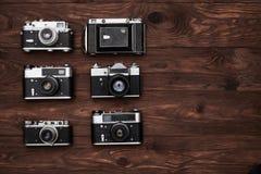 Κινηματογράφηση σε πρώτο πλάνο της συλλογής των εκλεκτής ποιότητας καμερών με ένα διάστημα αντιγράφων Στοκ Εικόνα
