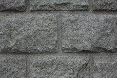 Κινηματογράφηση σε πρώτο πλάνο του γκρίζου υποβάθρου σύστασης γρανίτη Τοίχος πετρών γρανίτη Στοκ Φωτογραφίες
