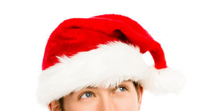 Κινηματογράφηση σε πρώτο πλάνο του καυκάσιου ατόμου που φορά το καπέλο Χριστουγέννων για το λευκό santa Στοκ φωτογραφία με δικαίωμα ελεύθερης χρήσης