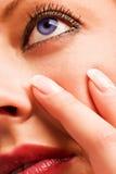 Πρόσωπο ενός κοριτσιού με το μπλε μάτι Στοκ εικόνα με δικαίωμα ελεύθερης χρήσης