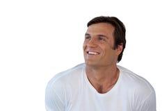 Κινηματογράφηση σε πρώτο πλάνο του στοχαστικού χαμογελώντας ώριμου ατόμου που κοιτάζει μακριά Στοκ φωτογραφία με δικαίωμα ελεύθερης χρήσης