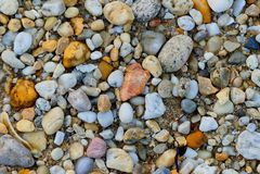 Κινηματογράφηση σε πρώτο πλάνο των πετρών αμμοχάλικου παραλιών Στοκ Εικόνες