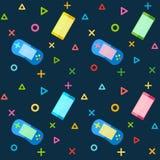 Κινητά τηλέφωνα και ζωηρόχρωμοι ελεγκτές μαξιλαριών παιχνιδιών Στοκ Φωτογραφία