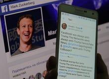 Κινητή συσκευή με τη σελίδα του Ντόναλντ Τραμπ και τη σελίδα Μαρκ Ζουκεμπερκ στοκ εικόνα