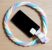 Κινητός και ένας κύκλος marshmallow Στοκ εικόνες με δικαίωμα ελεύθερης χρήσης