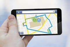 Κινητό τηλέφωνο προγραμματισμού διαδρομών Στοκ Εικόνες