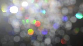 Κινούμενη ζωηρόχρωμη όμορφη θολωμένη bokeh σύσταση διακοπών Ακτινοβολήστε πολύχρωμο φως απόθεμα βίντεο