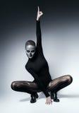 Κινούμενη μοντέρνη γυναίκα με το κρανίο στο πρόσωπο Στοκ Φωτογραφίες