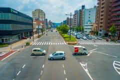 ΚΙΟΤΟ, ΙΑΠΩΝΙΑ - 5 ΙΟΥΛΊΟΥ 2017: Εναέρια άποψη των αυτοκινήτων στην οδό του Κιότο στην Ιαπωνία Η μητρόπολη του Κιότο είναι ενός μ στοκ φωτογραφίες