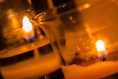 Κλείστε αυξημένος των αναμμένων κεριών στοκ εικόνα