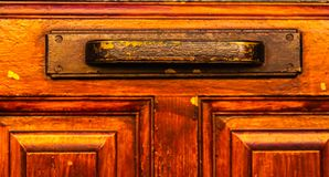Κλείστε επάνω σε μια λαβή πορτών με τα διακοσμητικά στοιχεία, πόρτα decorat Στοκ Εικόνες