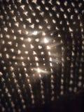 κλείστε επάνω της σύστασης υφάσματος τρυπών με το φως που έρχεται κατευθείαν Στοκ εικόνα με δικαίωμα ελεύθερης χρήσης