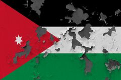 Κλείστε επάνω τη βρώμικη, χαλασμένη και ξεπερασμένη σημαία της Ιορδανίας στην αποφλοίωση τοίχων από το χρώμα για να δείτε την εσω στοκ εικόνες με δικαίωμα ελεύθερης χρήσης