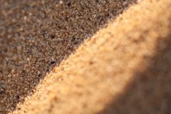 Κλείστε επάνω τη μακρο σύσταση του αμμόλοφου άμμου Στοκ φωτογραφία με δικαίωμα ελεύθερης χρήσης