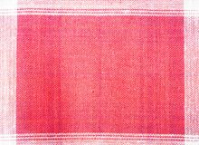 Κλείστε επάνω το κόκκινο και άσπρο υπόβαθρο σχεδίων υφάσματος Στοκ Εικόνα