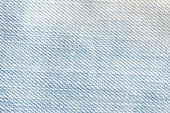 Κλείστε επάνω το φωτεινό υπόβαθρο σύστασης επιφάνειας τζιν παντελόνι τζιν Στοκ φωτογραφίες με δικαίωμα ελεύθερης χρήσης