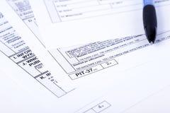 Κοίλωμα φορολογικής δήλωσης Στοκ φωτογραφία με δικαίωμα ελεύθερης χρήσης