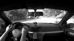 Κοιτάξτε επίμονα Splavy, Τσεχία - 12 Αυγούστου 2017: το οδηγώντας αυτοκίνητο Opel Astra Χ στο χωριό κοιτάζει επίμονα Splavy κοντά απόθεμα βίντεο