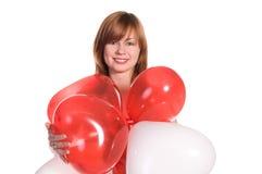 Κοκκινομάλλες κορίτσι σε ένα ρόδινο φόρεμα με τα μπαλόνια Στοκ Φωτογραφίες
