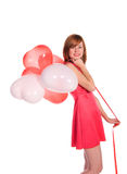 Κοκκινομάλλες κορίτσι σε ένα ρόδινο φόρεμα με τα μπαλόνια Στοκ φωτογραφία με δικαίωμα ελεύθερης χρήσης