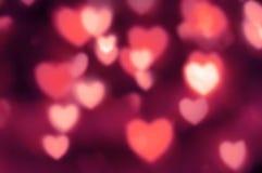 Κοκκινωπός-ρόδινα φω'τα ως καρδιές έξω--εστίασης Στοκ Φωτογραφία