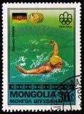 Κολυμβητής Kornelia Ender της Γερμανίας, από τους Ολυμπιακούς Αγώνες σειράς `, Μόντρεαλ - νικητές `, circa 1976 χρυσών μεταλλίων Στοκ Φωτογραφίες