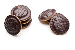 Κομμάτια σοκολάτας σε μια άσπρη ανασκόπηση Στοκ Εικόνες