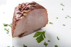 Κομμάτι καπνισμένου του χοιρινό κρέας ζαμπόν με τα χορτάρια Στοκ φωτογραφία με δικαίωμα ελεύθερης χρήσης