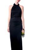 Κομψή γυναίκα Κομμάτων με ένα μπουκάλι του κρασιού Στοκ φωτογραφία με δικαίωμα ελεύθερης χρήσης