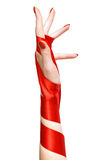 κομψή γυναίκα κορδελλών χεριών κόκκινη Στοκ Εικόνες