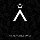 Κομψή κάρτα Χριστουγέννων με ένα συμβολικό δέντρο Στοκ Φωτογραφία