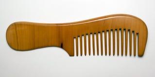 Κομψή ξύλινη χτένα στο άσπρο υπόβαθρο Στοκ φωτογραφία με δικαίωμα ελεύθερης χρήσης