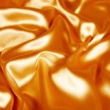 κομψό χρυσό μετάξι υφάσματ&omicro Στοκ εικόνα με δικαίωμα ελεύθερης χρήσης