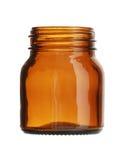 Κοντό καφετί ευρύ στόμα μπουκαλιών γυαλιού που απομονώνεται στο άσπρο υπόβαθρο στοκ εικόνα