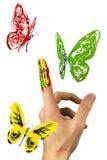 Κοπάδι των χρωματισμένων πεταλούδων που πετούν γύρω από το δάχτυλο Στοκ Εικόνα