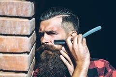 Κοπή Hipster με το ξυράφι Στοκ εικόνες με δικαίωμα ελεύθερης χρήσης