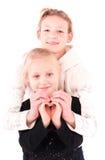 2 κορίτσια εφήβων σε ένα άσπρο υπόβαθρο Στοκ εικόνες με δικαίωμα ελεύθερης χρήσης