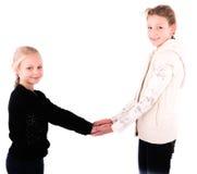 2 κορίτσια εφήβων σε ένα άσπρο υπόβαθρο Στοκ Φωτογραφίες
