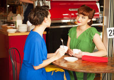 Κορίτσια στον καφέ Στοκ Εικόνα