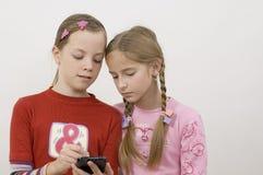 κορίτσια palmtop Στοκ Εικόνες