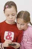 κορίτσια palmtop Στοκ Εικόνα