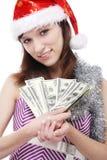 Κορίτσι Άγιος Βασίλης με τα χρήματα Στοκ Φωτογραφίες