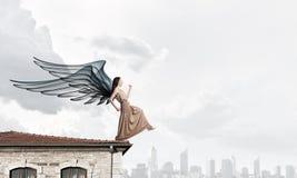 Κορίτσι αγγέλου στο φόρεμα Στοκ Φωτογραφίες