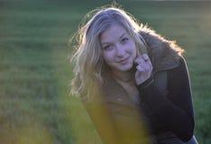 Κορίτσι από το ηλιοβασίλεμα Στοκ Φωτογραφία