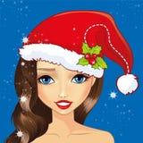 Κορίτσι ειδώλων με το καπέλο Χριστουγέννων απεικόνιση αποθεμάτων