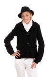 Κορίτσι εφήβων με το μαύρα χειμερινά παλτό και το καπέλο Στοκ Φωτογραφία