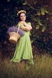 Κορίτσι θερινών Floral νεράιδων με Lavender το καλάθι Στοκ Εικόνες