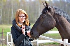 Κορίτσι και άλογο Στοκ Φωτογραφίες